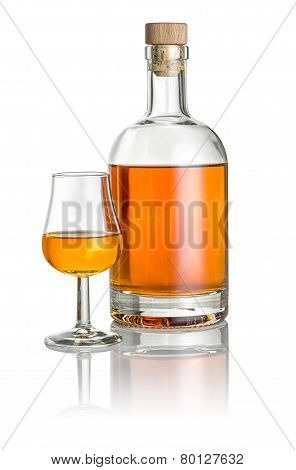 Bottle and snifter filled with amber liquid