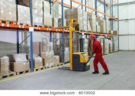 Worker in red uniform at work in warehouse