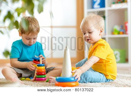 children boys with toys in playroom