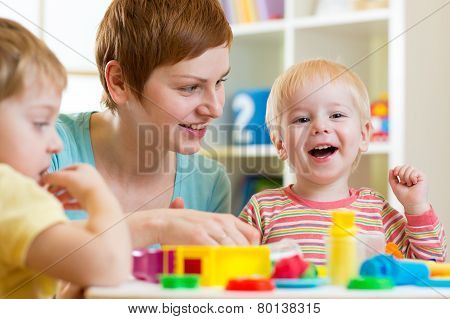 kids or children and mother play colorful clay toy