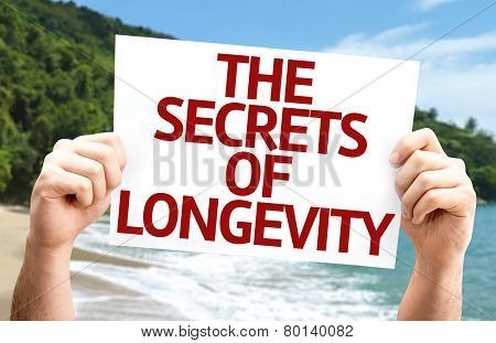 The Secrets of Longevity card with a beach on background