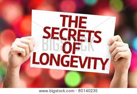 The Secrets of Longevity card with colorful background with defocused lights