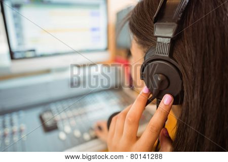 University student mixing audio in a studio of a radio