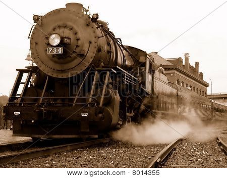 Steam engine at station in sepia tone