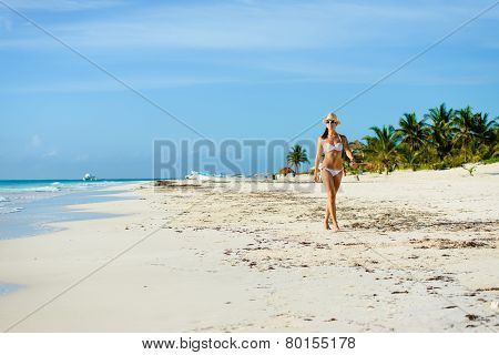 Tanned Attractive Woman In Bikini On Tropical Natural Beach