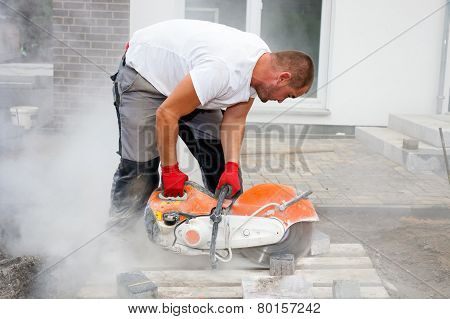 Stone Cutter At Work On Construction Site.