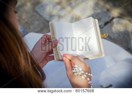 Young Girl Reading Blank Prayer Book