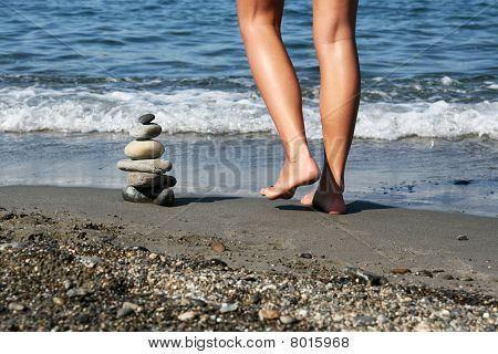 Pile Of Stones And Female Legs
