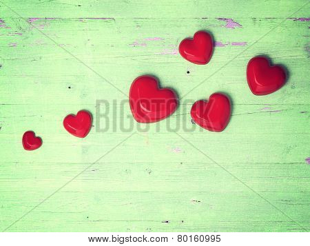 Top view of checked  heart decoration on wooden background