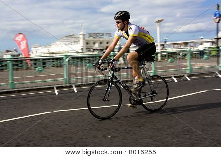 Cyclist Passes Brighton Pier