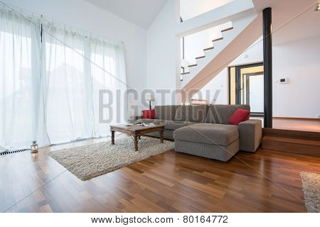 Wooden Parquet And Small Carpet