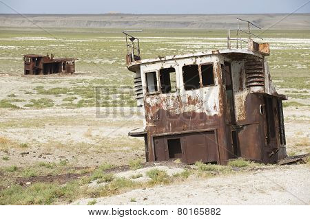 Rusted remains of fishing boats,  Aralsk, Kazakhstan.