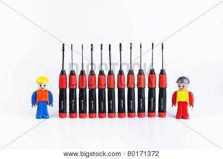 Construction workers with set of screwdriver