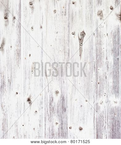 Grunge wooden board painted white.