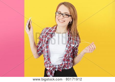 Woman Dancing With Headphones Listening To Music On Smartphone.