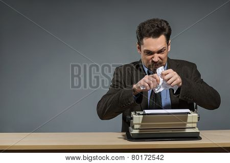 Inspired author throwing crumpled paper