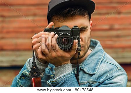 Hipster Photographer with camera