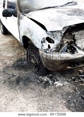 White pickup truck burned out and wrecked on roadside