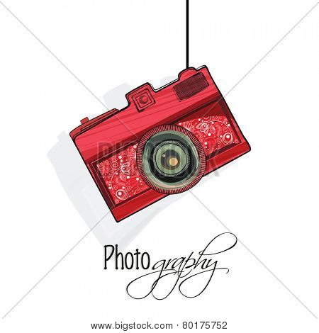 Stylish floral design decorated camera hanging on white background for photography.
