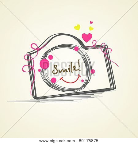 Creative photographic camera with colorful ribbons and hearts on beige background.