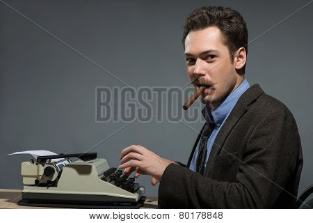Author smoking cigar at typewriter