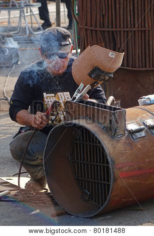 Welder Prepares To Join Two Metals Together