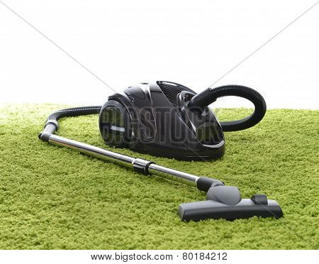 Powerfull Black Vacuum Cleaner On Green Carpet Floor