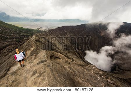 Hikers Walking Around Mount Bromo In Java, Indonesia