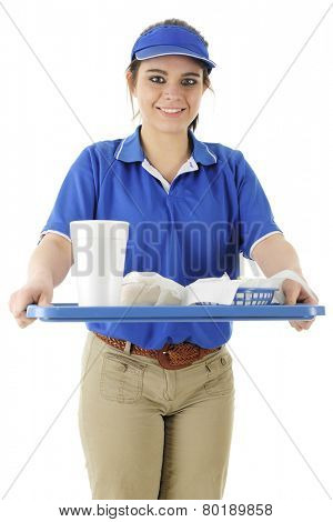 A pretty young fast food server bringing an order to the viewer.  On a white background.