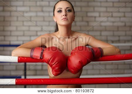 Seductive woman posing naked in boxing ring