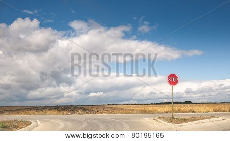 Country view with lonely stop sign