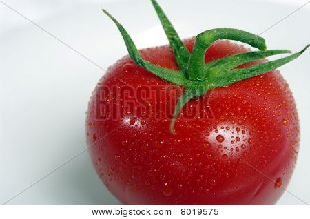 Tomatoe on white plate