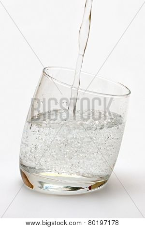 Glass with mineral water.