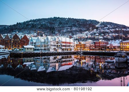 Bergen, Norway - December 27, 2014: Famous Bryggen street with wooden colored houses in Bergen at Christmas, Norway