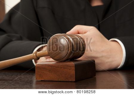 Judge. Referee hammer and a man in judicial robes