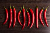 stock photo of chili peppers  - Red Chili pepper on a wooden background - JPG