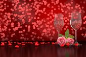 stock photo of champagne color  - 3d rendering of Champagne glasses and roses hearts in front of a colorful bokeh background - JPG