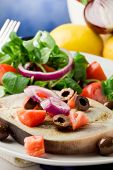 stock photo of swordfish  - grilled swordfish with mixed salad on white towel in front of blue background - JPG