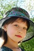 pic of ruddy-faced  - The ruddy girl in a hat in summer day - JPG
