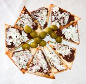 stock photo of greedy  - finger food with olive and cheese very greedy - JPG