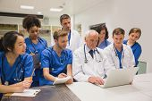 stock photo of professor  - Medical students and professor using laptop at the university - JPG