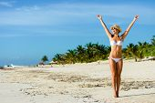 picture of joy  - Beautiful blissful woman in white bikini enjoying tropical beach and caribbean summer vacation - JPG