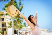 picture of playa del carmen  - Relaxed cheerful woman enjoying tropical caribbean vacation at the beach in Playa del Carmen Riviera Maya Mexico - JPG