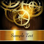image of gear wheels  - Metallic gold banner and  gear wheels on dark dirty surface with blots - JPG