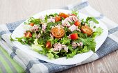 pic of masago  - Mixed salad with tuna and tomatoes on a wooden background - JPG