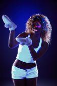 picture of uv-light  - Image of curly model in warm gloves under UV light - JPG