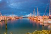 image of cloud formation  - Between cloud layer and calm water, Marina at night, Tauranga New Zealand. Long exposure 30 seconds. ** Note: Soft Focus at 100%, best at smaller sizes - JPG