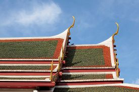 image of apex  - gable apex on temple roof with blue sky background - JPG