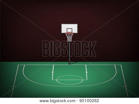 Basketball Hoop On Empty Green Court