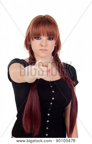 Teenage girl dressed in black with a piercing pointing at camera on white background